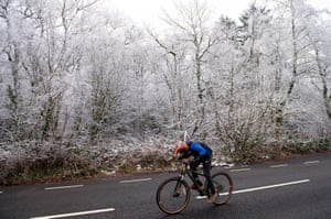 A cyclist passes through a frozen Lickey Hills Country Park, Birmingham