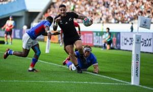New Zealand's scrum-half TJ Perenara dives to score in the corner.