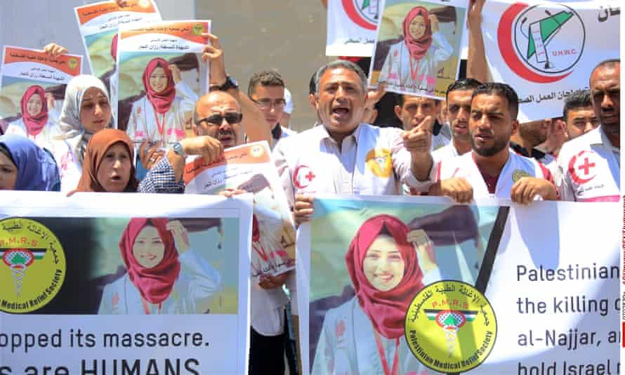 Palestinian medics protest in Gaza against the killing of the nurse Razan Al-Najjar, who was shot dead by Israeli soldiers.