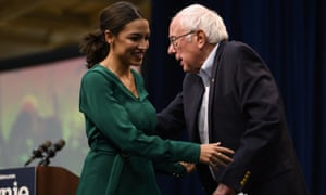 Representative Alexandria Ocasio-Cortez on stage with Senator Bernie Sanders (I-VT) during the climate crisis summit at Drake University on 9 November.