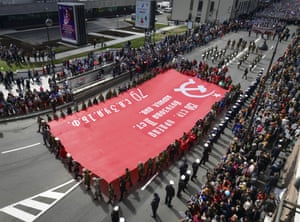 Service personnel carry a victory banner in Vladivostok