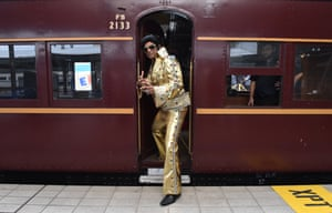 Elvis impersonator Alfred Vaz climbs aboard.