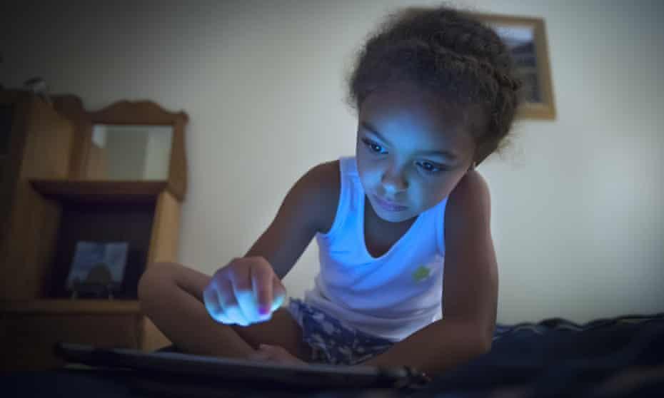 A girl uses a tablet
