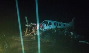 A damaged plane surrounded by floodwaters in Papua, Indonesia.