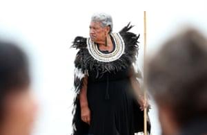 Kuia waits for waka to arrive outside Te Tiriti o Waitangi marae.