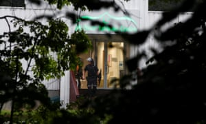 Police officers walk out of the al-Noor Islamic centre near Oslo.