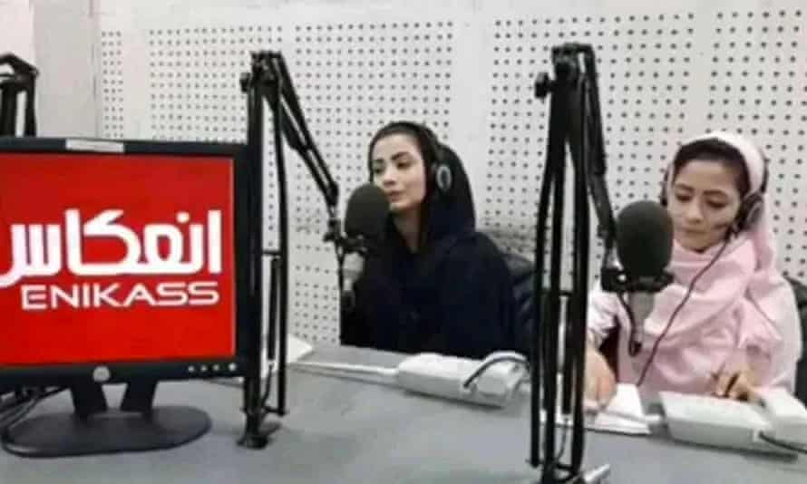 Nadia Momand and Haya Habibi siting in a studio in front of microphones