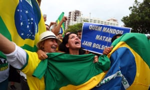 Supporters react near the house of Jair Bolsonaro, far-right lawmaker and presidential candidate during the presidential election, in Rio de Janeiro on Sunday.