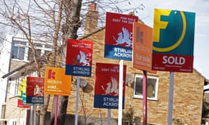 A row of estate agent signs