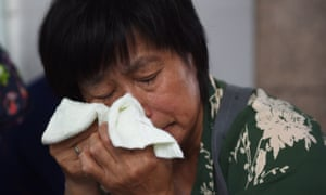 A relative of a passenger on the missing Malaysia Airlines flight MH370 outside the Malaysia Airlines office in Beijing on Thursday.