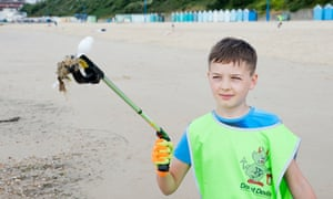 A young volunteer on the beach.