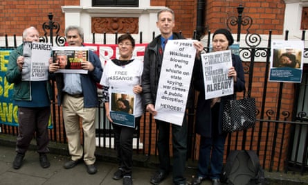 Peter Tatchell (second from right) holds a message of support for WikiLeaks outside the Ecuadorian embassy in London.