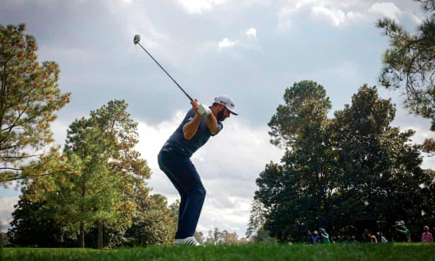 A view from behind the tee as Dustin Johnson hits his tee shot on the 9th