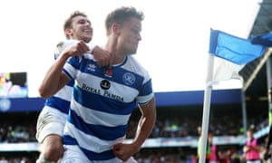 QPR's Matt Smith celebrates his winning goal against Wolves by sparring with a Loftus Road corner flag.