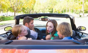 Kids and parents in a car
