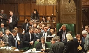 MPs surrounding John Bercow in the Speaker's chair as he used his casting vote after a tie, the first time a Speaker had had to do that since 1993.