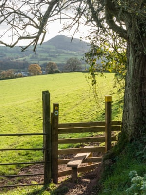 Offa's Dyke National TrailStile with sign and view to the Skirrid.