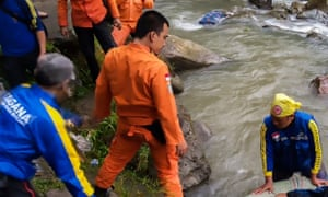 Indonesia's national search and rescue agency (BASARNAS) attends the bus crash in South Sumatra, after a vehicle plunged into a ravine.