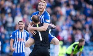 Kilmarnock's Stuart Findlay celebrates at the final whistle with Jamie MacDonald.
