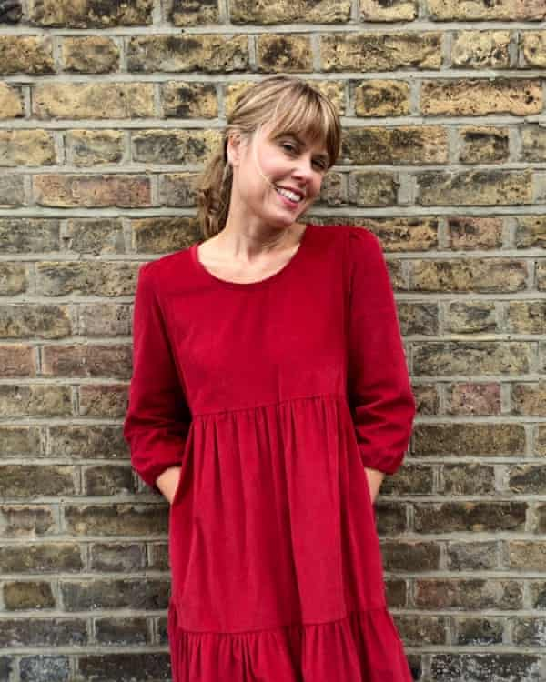 Justine Tabak wearing a Petticoat Lane red corduroy dress from her Match Girl collection.