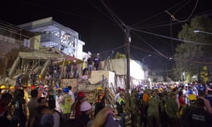 The three-story building collapsed killing scores of students and trapping another 30.