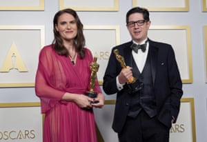 Alice Doyard, left, and Anthony Giacchino pose with the award for best documentary short subject for Guardian production Colette