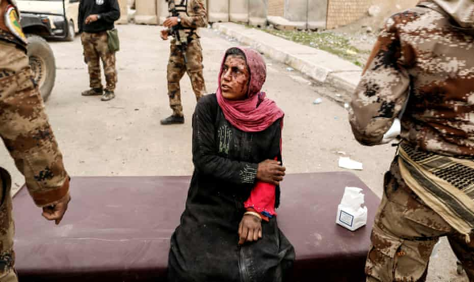 A woman injured in a mortar attack is treated by medics in a field clinic as Iraqi forces battle against Islamic State militants in western Mosul, on 2 March
