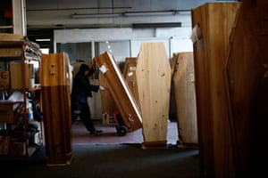 A worker prepares a coffin for a Covid-19 victim at a funeral logistic centre in Ris-Orangis, near Paris, as the spread of the coronavirus continues in France