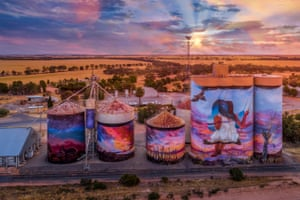 These GrainCorp silos at Sea Lake in north-west Victoria show a young girl siting on a swing looking over Lake Tyrell as the sun sets. Artists Joel Fergie and Travis Vinson were inspired by the traditional stories of the Boorong people and early Indigenous astrology.