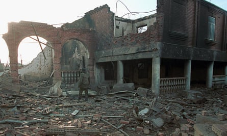 A Russian soldier inspect the ruins of the house of the then Chechen president, Aslan Maskhadov, in Grozny in January 2000.