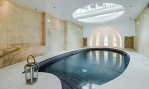 A basement development in Cheyne Place, Chelsea, featuring an oval blue-tiled pool inspired by the Greek islands.