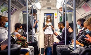 Passengers wearing face masks on the Jubilee Line in London. Officials in the capital fear tougher measures could soon be needed as Covid infection rates continue to rise.