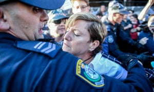 Christine Forster, Liberal councillor in the City of Sydney and sister of former prime minister Tony Abbott, is helped through the crowd.