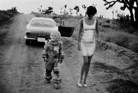 The actor Debbie Lee Carrington and model Helena Christensen shot in El Mirage, California, 1990.