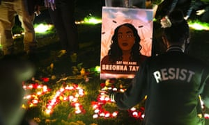 Protesters light candles and lay flowers outside the Federal Courthouse in remembrance of Breonna Taylor in Seattle, Washington.