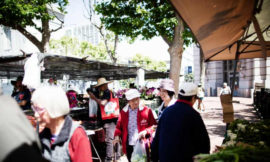 Shoppers peruse the stalls at the Heart of the City farmers' market in San Francisco.