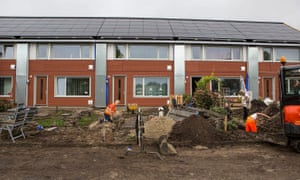 Putting finishing touch to one of Energiesprong's net zero energy houses in Nieuw Buinen in the Netherlands