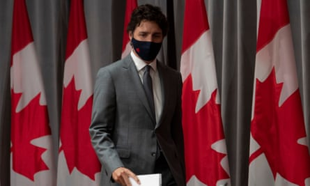 Trudeau arrives for a news conference in Ottawa on Wednesday. He said: 'We were able to control the virus better than many of our allies, particularly including our neighbor.'