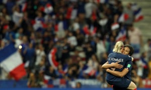 France's Eugenie Le Sommer celebrates with Wendie Renard after scoring their second goal from the penalty spot.