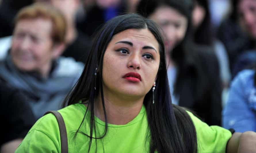 A follower of Sergio Fajardo shows her disappointment after her candidate came third in the poll.