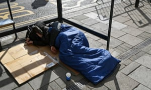 A homeless person sleeps on the street in Windsor.