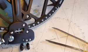 Nautical chart, compass and sextant, close-up