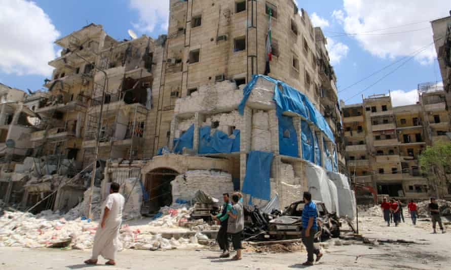 People inspect the damage at the Médecins Sans Frontières hospital in Aleppo, Syria.