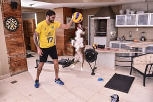 Brazilian volleyball player Evandro Guerra trains at home in Belo Horizonte – with help from his dog, Vida.