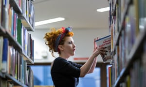 Female student looking at books in library