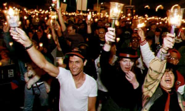 People march down San Francisco's Market Street for the 10th international Aids candlelight march in 1993.