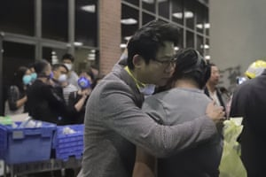 The principal hugs a student on the campus