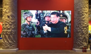 An exhibition in Beijing celebrating Xi's first term show him brandishing a rifle, caressing a baby elephant and rubbing shoulders with British royalty.