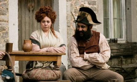 Madame Thenardier (Olivia Colman) and Thenardier (Adeel Akhtar).