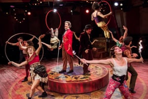 Marcus Brigstocke, in red, as Barnum and cast at the Menier Chocolate Factory.